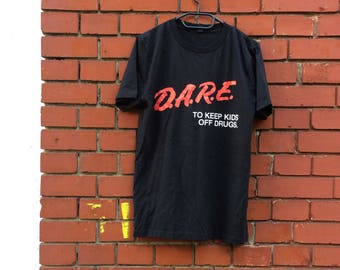Dare to keep the kids off drugs screen printed t-shirt