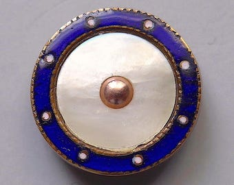 Waistcoat button, antique.   Blue & white champleve enamel decorative border with a slightly concave pearl centre, gilt.  c1900.