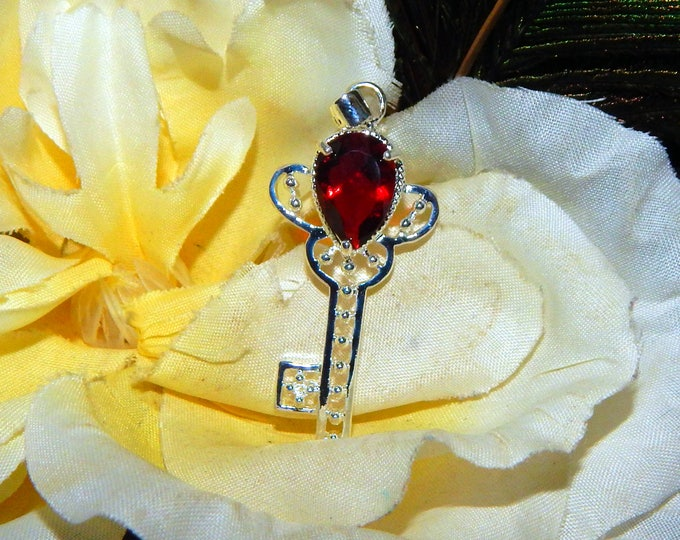 Archangel Uriel Key inspired vessel - Handcrafted Garnet Quartz Key pendant with chain