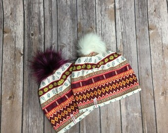 Pom Pom winter hat for woman in jersey, lined with fleece.