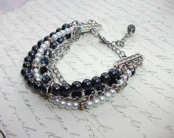 Multi strand black and silverpearls and crystal bracelet