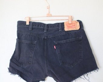 vintage 1980's distressed black cut off levis 501 button fly  jean shorts 36 38