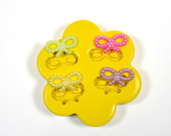 1696 Tiny pearl textured Bow ties Silicone Rubber Food Safe Mold Mould-resin, clay, fondant, jewlery, crafting etc.