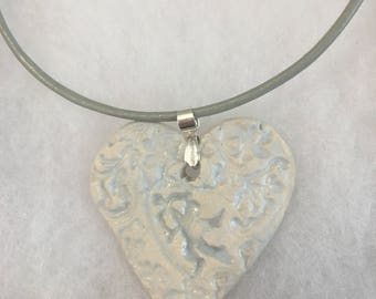 Ceramic Heart Pendant Necklace with Cupid imprint on a Sterling Silver and Leather cord, boho, one of a kind, handmade