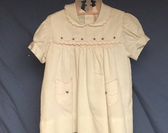 Vintage White Baby Dress with Pink Embroidered Trim and Two Pockets