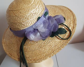 Vintage Ladies Hat Real Straw  1970s Wide Brim Hat  Straw with Lilac banding and flower side by  THE HAT GUILD