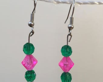 Green and pink dangle earrings