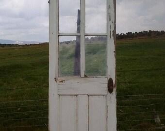 Antique salvaged door with 4 pane windows, vintage door