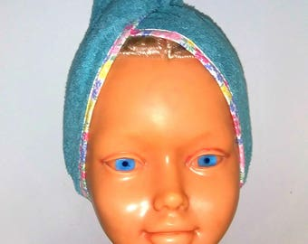 Dry-head decorated with a floral turquoise blue