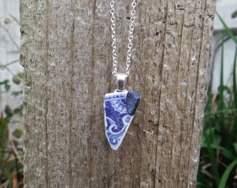 Pottery and mussel shell fragment pendant
