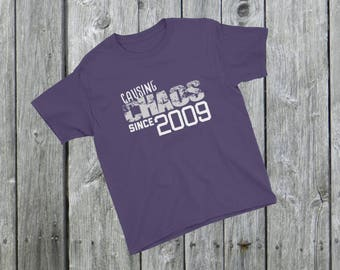 Causing CHAOS since 2009 T-Shirt 9th Birthday 9 years old Kids, Boys, Girls, Infants, Youth Short Sleeve T-Shirt old Funny gag gift, unique