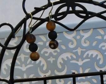 Nickel free, lava bead diffuser earrings, tigers eye stone.