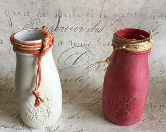 Glass bottle colored wax-finished and completed with colored twine.