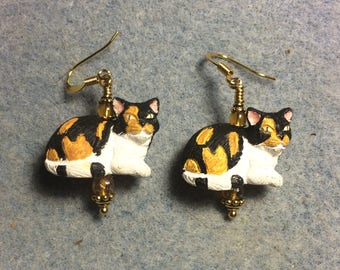 Calico ceramic cat bead earrings adorned with amber Czech glass beads.