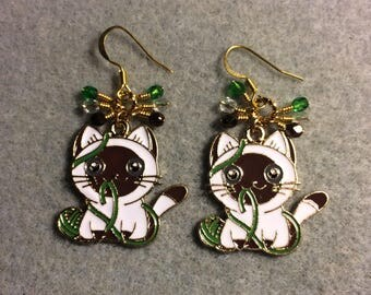 Brown, white, and green enamel kitty cat charm earrings adorned with tiny dangling brown, white, and green Czech glass beads.