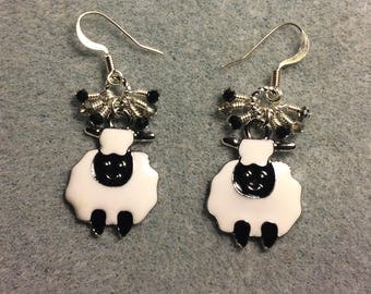 Black and white enamel sheep charm earrings adorned with tiny dangling black and silver Chinese crystal beads.