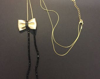 "Necklace ""POUPETTE"" black and gold leather bow"