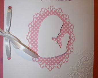 Cover booklet of baptism or communion personalized cardboard embossed by hand in shades of pink and white