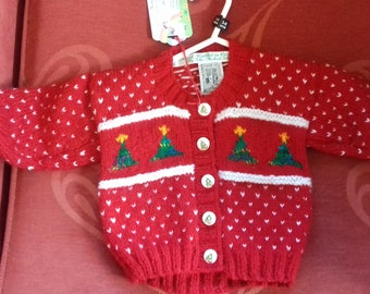 Hand knitted Christmas themed cardigan to fit a child aged 3-6 months old