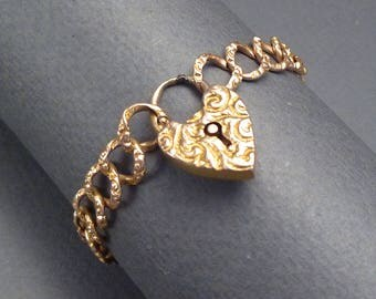 12K Gold Curb Bracelet with heart shaped lock for a small wrist #2