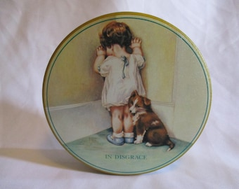 Vintage round tin featuring In Disgrace by Bessie Pease Gutman