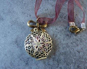 Vintage bronze filigree pendant
