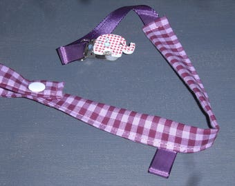 Purple gingham pacifier adorned with an elephant