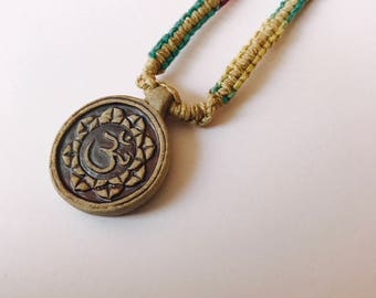 Ohm Ceramic Pendant on muti color handmade hemp necklace 15.5 inches