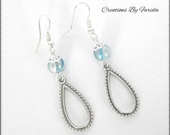 Silver plated earrings with blue wave bead and charm drop