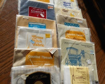 A Lot of Cross Stitching Fabric -12 packages, multiple colors and sizes