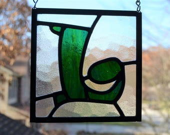 Leaded stained glass suncatcher of green letter 'L' 5.75 inches square