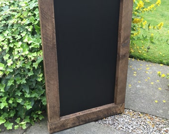 Beautiful Rustic wooden chalkboard with nails and knots in the frame.
