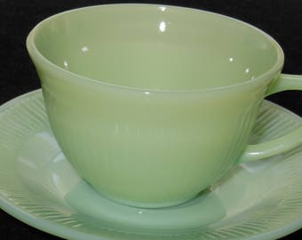 "Fire King ""Jane Ray"" Cup and Saucer Set in Jade-ite from Anchor Hocking, mid 1940's to mid 1960's."