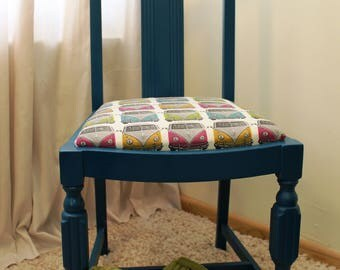 Turquoise blue, hand painted chair, newly reupholstered in a wacky VW Camper van fabric