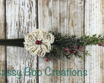 Handmade Christmas newborn tieback with off white flower and evergreen branch