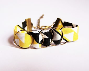 Bracelet yellow and black and bronze rings brass