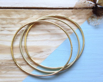 Brass bangle trio | Handmade stacking bangle set in solid brass, three different finishes | Recycled packaging | Brighton UK.