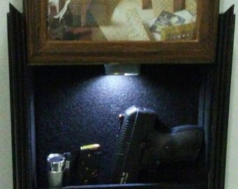 gun hidden compartment furniture, photo frame.  Listed for charity
