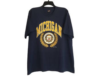 Vintage University of Michigan Seal U of M Wolverines Maize and Navy T-Shirt Large/X-Large