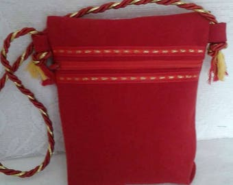 Little girl in red Suede, red and gold trim, bag closed with zipper
