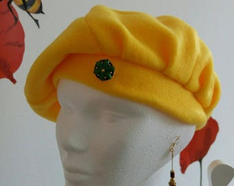 Yellow beret with d pin d bee wax