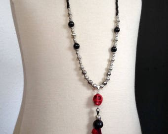 Necklace with Tibetan silver beads, glass petles, howlite skull and Pompom ribbons