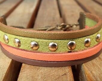 Suede multi strand bracelet, bronze arrow connector