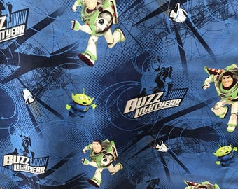 """Buzz Lightyear with little green man 2 by Springs Creative, 43-44"""" wide, 100% cotton, by the half yard"""