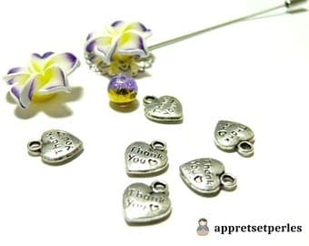 charm 2 50pieces has 7421 Merci thank you to old silver pendant