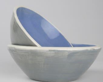 Matching Blue, Gray, and White Ceramic Nesting Ring Dish Bowls.