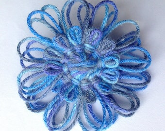 Handmade brooch with blue flower
