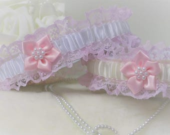 Wedding garter/Bridal garter. Pink lace with White or Ivory satin trim. Poinsettia flower, pearls & 'Something Blue'