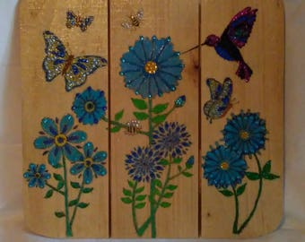 Wood burned art on fence piece blue flowers butterflies bees and hummingbirds painted and embellished with crystals