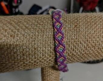 purple, peach, green and white Diamond pattern friendship bracelet
